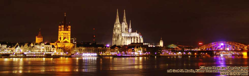 Cologne on the Rhine River with boats on early New Years Eve Evening.